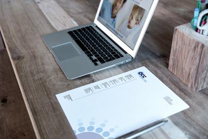 Letterhead and MacBook Free Mockup